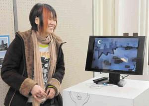 「たくさんの学生にアニメを見てもらいたい」と話す笠島さん=富山大高岡キャンパスで