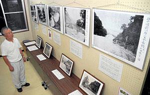 明治時代に黒部市内で撮影された貴重な写真が並ぶ会場=同市宇奈月町浦山で