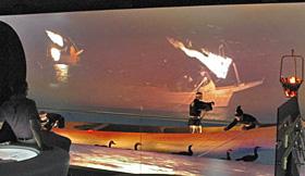 鵜飼いの様子が上映される「長良川うかいミュージアム」のスクリーン(奥)