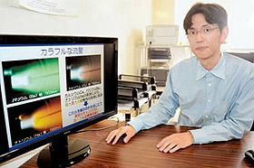 8日に地球への帰還をテーマに話す松井准教授=浜松市中区の静岡大浜松キャンパスで