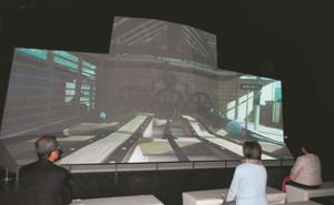 反射炉の構造などを映像で解説する大型スクリーン=伊豆の国市中の韮山反射炉ガイダンスセンターで