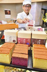 「富山米のカステラ」に期間限定で仲間入りした氷見産ブルーベリー味(手前中央)=射水市善光寺で