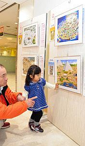 香川さんの作品の原画が並ぶ会場=富山市新富町で