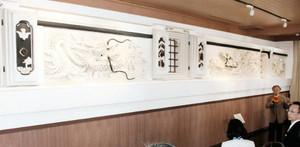 2匹の竜が向かい合う日本最大級の鏝絵「双龍」